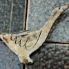 goose brooch on salt-glaze tiles
